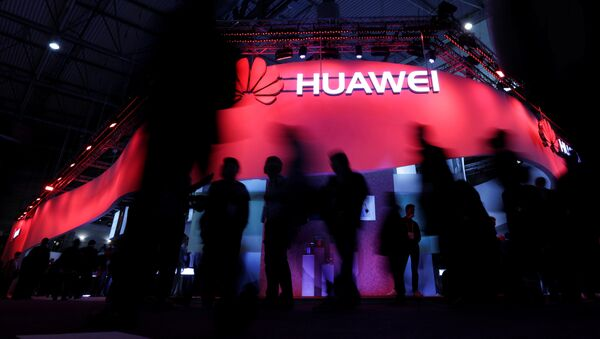 Visitors walk past Huawei's booth during Mobile World Congress in Barcelona, Spain, February 27, 2017 - Sputnik International