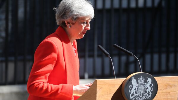 Britain's Prime Minister Theresa May reacts as she announces her resignation outside 10 Downing street in central London on May 24, 2019. - Sputnik International