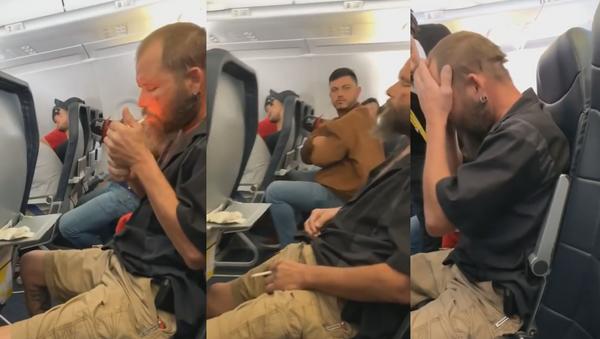 Seemingly Intoxicated Passenger Lights Cigarette on US Flight - Sputnik International