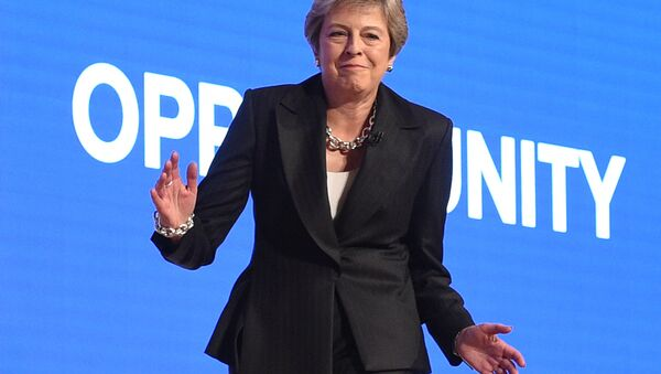 Britain's Prime Minister Theresa May dances a few steps as she takes the stage to give her keynote address on the fourth and final day of the Conservative Party Conference 2018 at the International Convention Centre in Birmingham, central England, on October 3, 2018 - Sputnik International