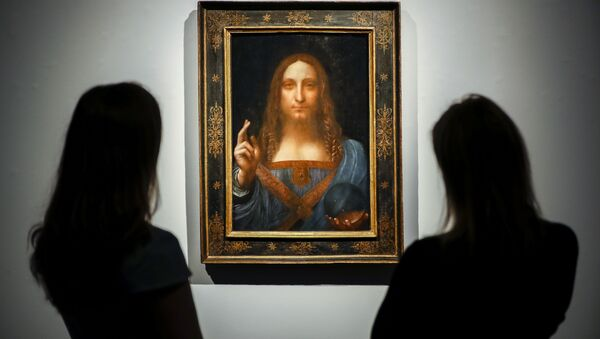 Christie's employees pose in front of a painting entitled Salvator Mundi by Italian polymath Leonardo da Vinci at a photocall at Christie's auction house in central London on October 22, 2017 ahead of its sale at Christie's New York on November 15, 2017 - Sputnik International