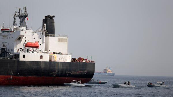 UAE Navy boats are seen next to the Saudi tanker Al Marzoqah off the Port of Fujairah, UAE, May 13, 2019 - Sputnik International