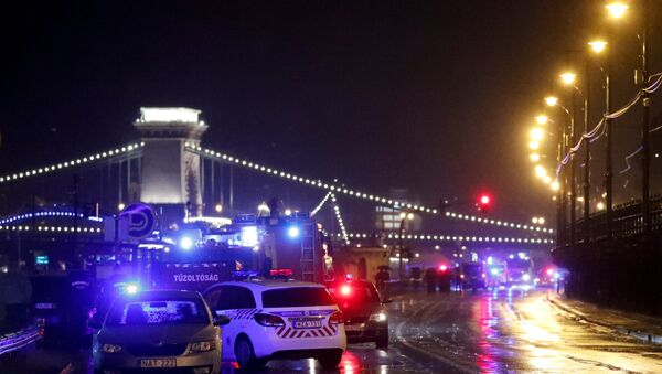 Police and fire brigade vehicles are seen on the Danube bank after tourist boat capsized on the river in Budapest, Hungary, May 29, 2019. - Sputnik International