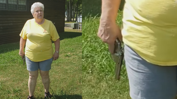 Elderly woman wielding a revolver confronts a couple attempting to have a picnic - Sputnik International