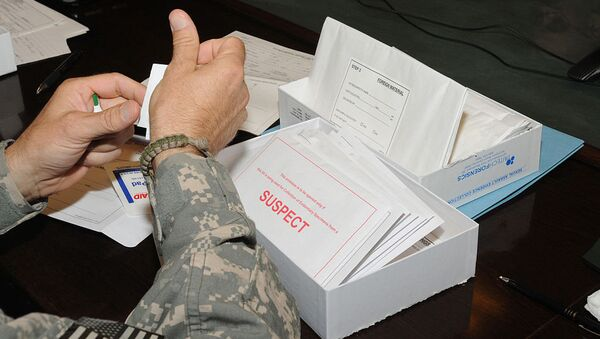 Medical professionals learn how to use the Sexual Assault Evidence Collection kit at Camp Phoenix near Kabul, Afghanistan, Aug. 15, 2010. The kit has several packets to collect evidence from a suspect and a patient of a sexual assault case. - Sputnik International
