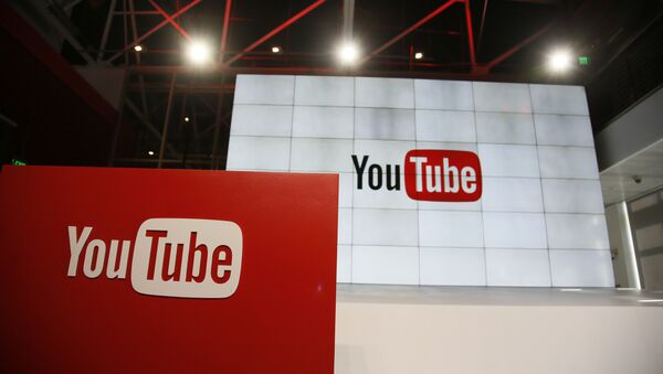 This Oct. 21, 2015, file photo shows signage inside the YouTube Space LA offices in Los Angeles. YouTube's inability to keep ads off unsavory videos is threatening to transform a rising star in Google's digital family into a problem child. The key question is whether a recently launched ad boycott of YouTube turns out to be short-lived or the start of a long-term marketing shift away that undercuts Google's growth, as well as Alphabet Inc., its corporate parent.  - Sputnik International