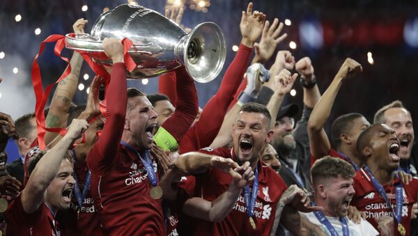 Liverpool's players celebrate with the trophy after winning the Champions League final soccer match between Tottenham Hotspur and Liverpool at the Wanda Metropolitano Stadium in Madrid, Sunday, June 2, 2019. Liverpool won 2-0. - Sputnik International
