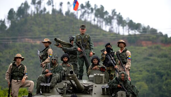 Venezuelan troops in different fatigues and carrying various weapons stand on a Russian-made BMP-3M IFV during the press conference given by Defence Minister general Vladimir Padrino Lopez at Fort Tiuna in Caracas on August 14, 2017 - Sputnik International