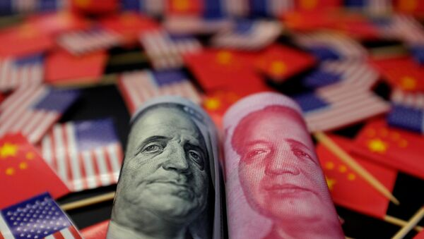 A U.S. dollar banknote featuring American founding father Benjamin Franklin and a China's yuan banknote featuring late Chinese chairman Mao Zedong are seen among U.S. and Chinese flags in this illustration picture taken May 20, 2019. Picture taken May 20, 2019 - Sputnik International