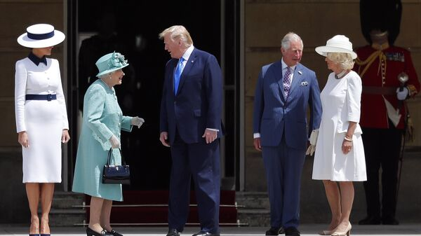 Britain's Queen Elizabeth II greets President Donald Trump, center, and first lady Melania Trump, left, with Britain's Prince Charles and Camilla, Duchess of Cornwall during a ceremonial welcome in the garden of Buckingham Palace in London, Monday, June 3, 2019 on the opening day of a three day state visit to Britain - Sputnik International