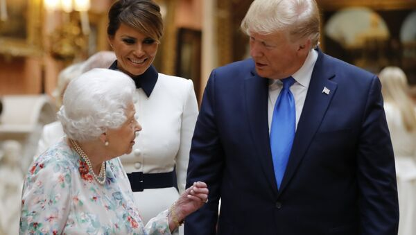 Britain's Queen Elizabeth speaks to U.S President Donald Trump and First Lady Melania Trump as they view U.S memorabilia from the Royal Collection, at Buckingham Palace, London, Monday, June 3, 2019 - Sputnik International
