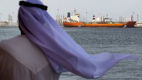 An Emirati man looks on at the port of Fujairah in the Gulf Emirate, on May 13, 2019 - Sputnik International