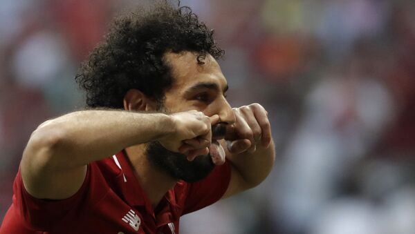Liverpool's Mohamed Salah celebrates after scoring his side's opening goal during the Champions League final soccer match between Tottenham Hotspur and Liverpool at the Wanda Metropolitano Stadium in Madrid, Saturday, June 1, 2019. - Sputnik International