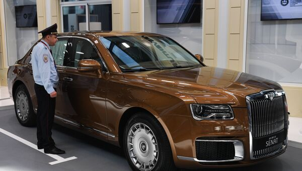 An Aurus Senate limousine is displayed at ExpoForum Convention and Exhibition Centre ahead of the St. Petersburg International Economic Forum (SPIEF) that will be held on June 6-8, in St. Petersburg, Russia - Sputnik International