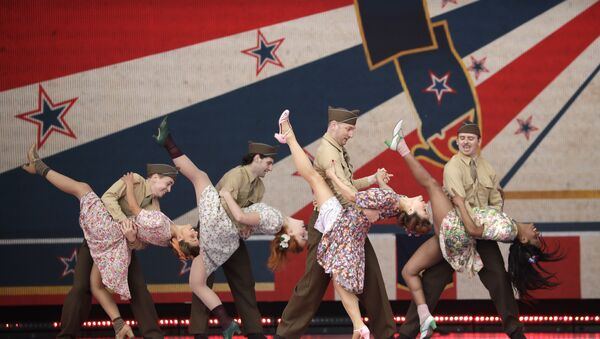 Dancers in period costume perform during an event to mark the 75th anniversary of D-Day in Portsmouth, England Wednesday, June 5, 2019 - Sputnik International