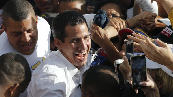 Venezuela's opposition leader and self-proclaimed interim president Juan Guaido greets supporters during a rally in Barinas, Venezuela, Saturday, June 1, 2019. Guaido is taking his campaign to oust President Nicolas Maduro to the birthplace of Hugo Chavez, the socialist leaders's mentor - Sputnik International