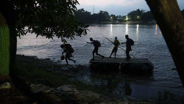 Migrants on rafts reach the Mexico shore after crossing the Suchiate river on the Guatemala – Mexico border, near Ciudad Hidalgo, Mexico, Wednesday, June 5, 2019 - Sputnik International