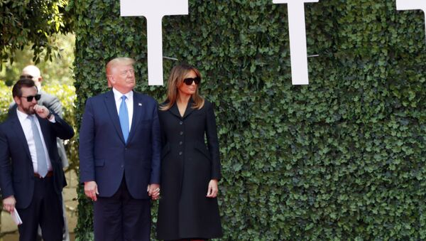 U.S. President Donald Trump and first lady Melania Trump arrive for a ceremony to mark the 75th anniversary of D-Day at the Normandy American Cemetery in Colleville-sur-Mer, Normandy, France, Thursday, June 6, 2019. World leaders are gathered Thursday in France to mark the 75th anniversary of the D-Day landings. (AP Photo/Thibault Camus) - Sputnik International