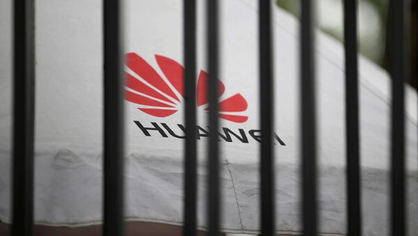 A Huawei logo is seen outside the fence at its headquarters in Shenzhen, Guangdong province, China May 29, 2019 - Sputnik International