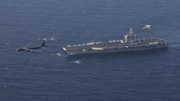 June 1, 2019 file photo, the USS Abraham Lincoln carrier and a U.S. Air Force B-52H Stratofortress, conduct joint exercises in the U.S. Central Command area of responsibility in Arabian sea - Sputnik International