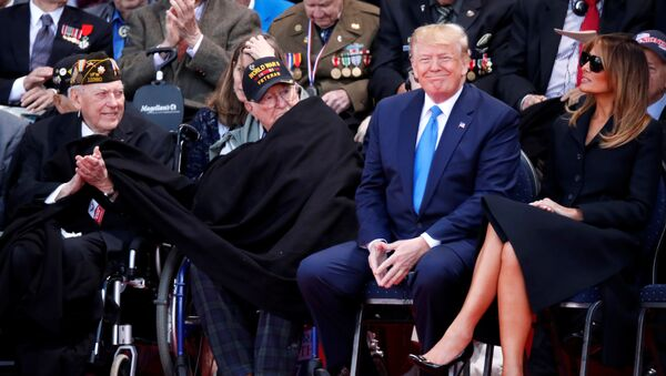 U.S President Donald Trump and First Lady Melania Trump sit next to WWII veterans during a ceremony to mark the 75th anniversary of the D-Day at the Normandy American Cemetery and Memorial in Colleville-sur-Mer, France, June 6, 2019 - Sputnik International