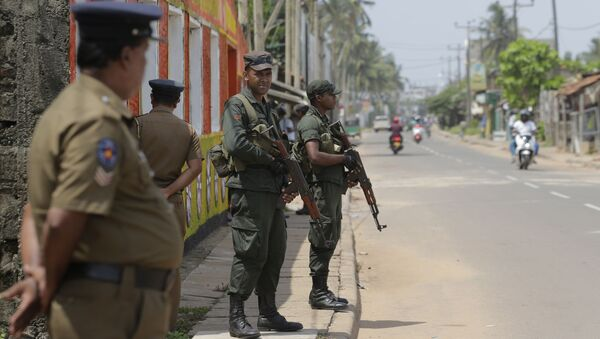 Sri Lankan army soldiers and police stand guard on a road in a Muslim neighborhood following overnight clashes in Poruthota, a village in Negombo, about 35 kilometers North of Colombo, Sri Lanka, Monday, May 6, 2019 - Sputnik International