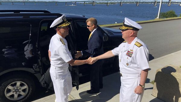 Adm. John Richardson, left, chief of naval operations, greets Rear Adm. Jeffrey Harley, president of the U.S. Naval War College, Tuesday, June 12, 2018, in Newport, R.I. U.S. Navy leaders are in Rhode Island to strategize with scholars about how technology and innovation will affect the nation's security. (AP Photo/Jennifer McDermott) - Sputnik International
