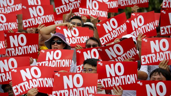 Protesters hold placards as they stage protest against the extradition law in Hong Kong, Sunday, June 9, 2019 - Sputnik International