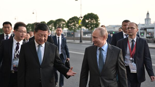 Vladimir Putin, Xi Jinping at SPIEF - Sputnik International