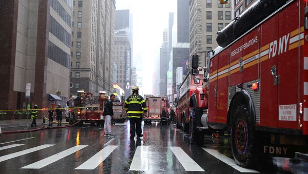 New York City Fire Department trucks and firefighters are seen outside 787 7th Avenue in midtown Manhattan where a helicopter was reported to have crashed in New York City, New York, U.S., June 10, 2019. REUTERS/Brendan McDermid - Sputnik International