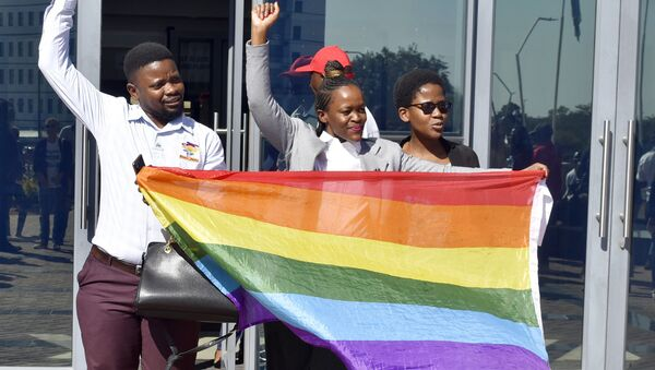 Activists celebrate outside the High Court in Gaborone, Botswana, Tuesday June 11, 2019. Botswana became the latest country to decriminalize gay sex when the High Court rejected as unconstitutional sections of the penal code that punish same-sex relations with up to seven years in prison. - Sputnik International