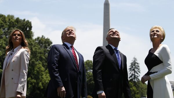 President Donald Trump, first lady Melania Trump, Polish President Andrzej Duda, and his wife Agata Kornhauser-Duda watch a flyover of two F-35 Joint Strike Fighter aircraft at the White House, Wednesday, 12 June 2019 in Washington. - Sputnik International