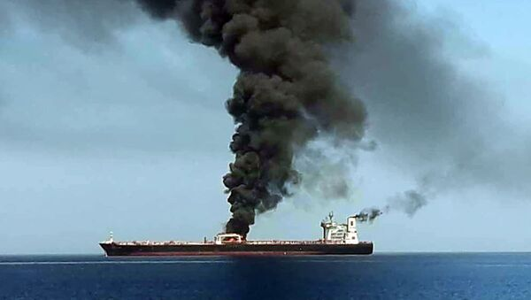 A picture obtained by AFP from Iranian State TV IRIB on June 13, 2019 reportedly shows smoke billowing from a tanker said to have been attacked off the coast of Oman, at un undisclosed location - Sputnik International