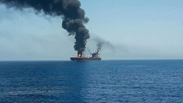 An oil tanker is seen after it was attacked at the Gulf of Oman, in waters between Gulf Arab states and Iran, June 13, 2019 - Sputnik International