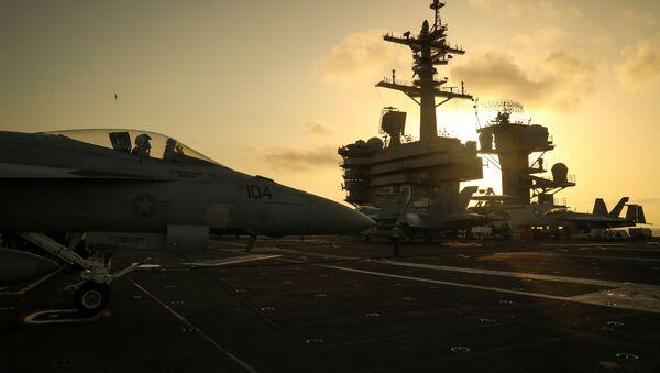 The sun sets behind the U.S. Navy aircraft carrier USS Abraham Lincoln, in Arabian Sea, June 3, 2019. Picture taken June 3, 2019 - Sputnik International
