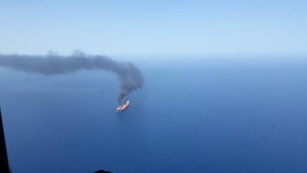 An oil tanker is seen after it was attacked in the Gulf of Oman, June 13, 2019 - Sputnik International