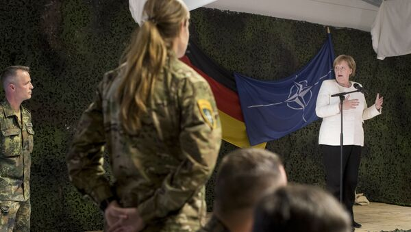 German Chancellor Angela Merkel delivers her speech during a meeting with German Bundeswehr soldiers of the NATO enhanced forward presence battalion at the Rukla military base - Sputnik International