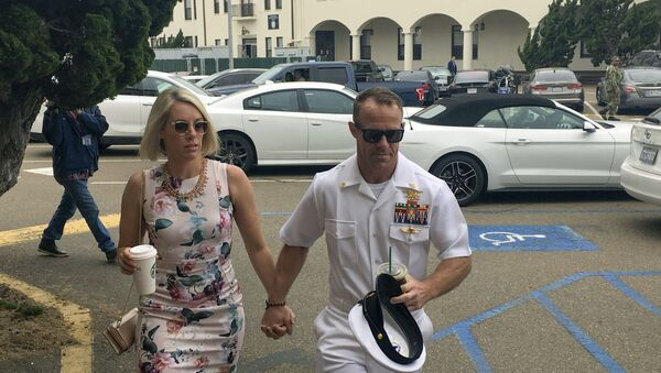 Navy Special Operations Chief Edward Gallagher, right, walks with his wife, Andrea Gallagher, as they arrive to military court on Naval Base San Diego, Thursday, June 20, 2019, in San Diego.  - Sputnik International