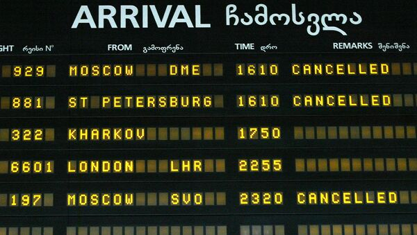 A view of an arrival-departure board with flights to Russia canceled seen at Tbilisi International airport - Sputnik International