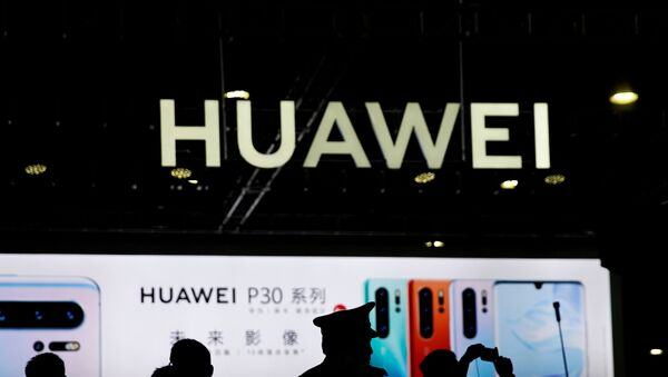 A Huawei company logo is seen at CES (Consumer Electronics Show) Asia 2019 in Shanghai, China  - Sputnik International