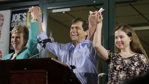 Former Congressman Joe Sestak, center, his wife Susan Sestak, left, and daughter Alex Sestak react after speaking to supporters gathered outside his campaign headquarters - Sputnik International