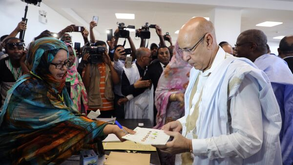 Ruling party presidential candidate and former Defense Minister Mohamed Ould El Ghazouani casts his ballot in Nouakchott, Mauritania - Sputnik International