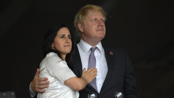 London's Mayor Boris Johnson (R) waits with his wife Marina Wheeler (L) prior to the start of the opening ceremony of the London 2012 Olympic Games on July 27, 2012 at the Olympic Stadium in London. - Sputnik International