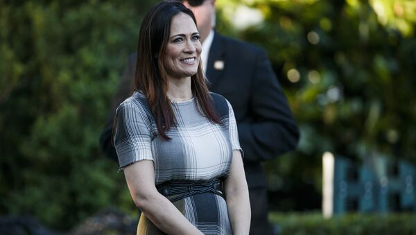 Stephanie Grisham, spokeswoman for first lady Melania Trump, watches as President Donald Trump and the first lady greet attendees during the annual Congressional Picnic on the South Lawn, Friday, June 21, 2019, in Washington.  - Sputnik International