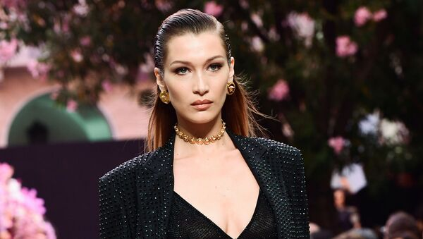 US model Bella Hadid model presents a creation for fashion house Versace during the presentation of its women's and men's spring/summer 2020 fashion collection in Milan on June 15, 2019 - Sputnik International