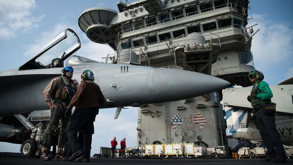 FILE - In this June 3, 2019 file photo, a pilot speaks to a crew member by an F/A-18 fighter jet on the deck of the USS Abraham Lincoln aircraft carrier in the Arabian Sea - Sputnik International