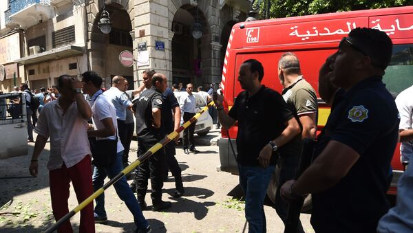 Tunisian security forces cordon off the site of an attack in the Tunisian capital's main avenue Habib Bourguiba on June 27, 2019. - Sputnik International