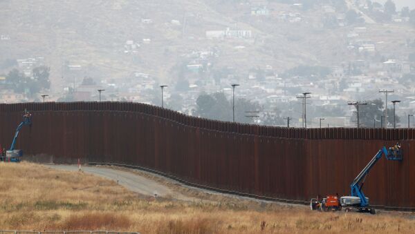 Workers weld sections of a newly replaced border wall with Tijuana, Mexico near the the Otay Mesa border crossing in San Diego, California May 31, 2019 - Sputnik International
