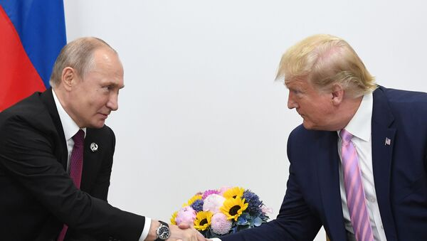 Russian President Vladimir Putin and U.S. President Donald Trump shake hands during a bilateral meeting at the at the Group of 20 (G20) leaders summit in Osaka, Japan. - Sputnik International
