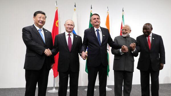 Russia's President Vladimir Putin (2nd L), Brazil's President Jair Bolsonaro (C), India's Prime Minister Narendra Modi (2nd R), China's President Xi Jinping (L) and South Africa's President Cyril Ramaphosa pose for a picture during the BRICS summit in Osaka, Japan June 28, 2019 - Sputnik International